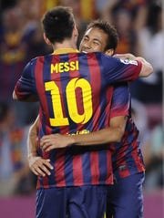FC Barcelona's Neymar, from Brazil, right, celebrates after scoring against Real Sociedad with his teammate Lionel Messi, from Argentina, during a Spanish La Liga soccer match at the Camp Nou stadium in Barcelona, Spain, Tuesday, Sept. 24, 2013. (AP Photo/Manu Fernandez)