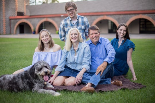 The Schroeder family poses for a portrait in August 2018 with their dog, Boomerang, just after state Rep. Andrea Schroeder learned she had stomach cancer. From left are Boomerang, Grace, Andrea, Luke (back row), Mark and Maggie Schroeder.