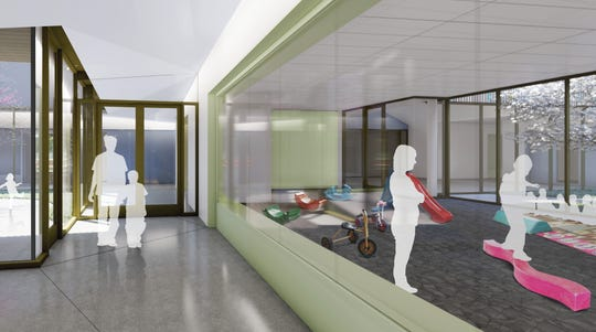 This architectural rendering depicts a view of the gross motor room inside the future Marygrove early learning center.