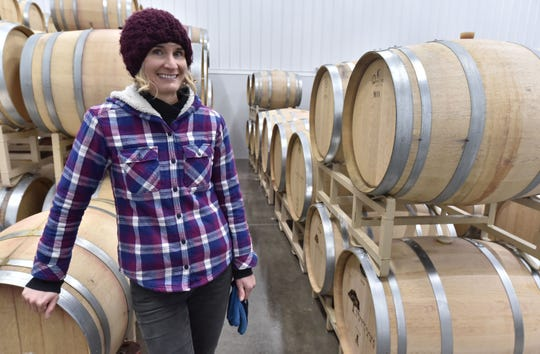 Winemaker Kasey Wierzba stands in the barrel storage room at Shady Lane Cellars Nov. 20. The Leelanau County facility produces 10 varieties of wines.