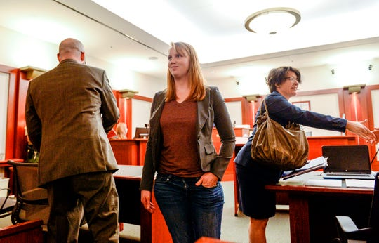 Tilli Buchanan smiles as she leaves Judge Kara Pettit's Third District Courtroom, Tuesday, Nov. 19, 2019, in Salt Lake City. Her attorneys Leah Farrell, with the AmericanCivil Liberties Unionof Utah, and Randy Richards argued on her behalf that Utah's lewdness statute is unconstitutional because it discriminates against women.