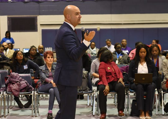 Dr. Nikolai Vitti, superintendent of Detroit Public Schools Community District, talks about the proposed closing of Communication and Media Arts High School during a conversation with parents and community members at the school on Nov. 19.