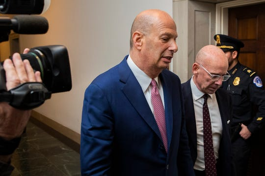 U.S. Ambassador to the European Union Gordon Sondland leaves Capitol Hill with his lawyer Robert Luskin, right, as they conclude his testimony during a public impeachment hearing of President Donald Trump's efforts to tie U.S. aid for Ukraine to investigations of his political opponents on Capitol Hill in Washington, Wednesday, Nov. 20, 2019.