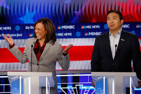 Democratic presidential candidate Sen. Kamala Harris, D-Calif., reacts while speaking as Democratic presidential candidate former technology executive Andrew Yang looks on during a Democratic presidential primary debate, Wednesday, Nov. 20, 2019, in Atlanta.