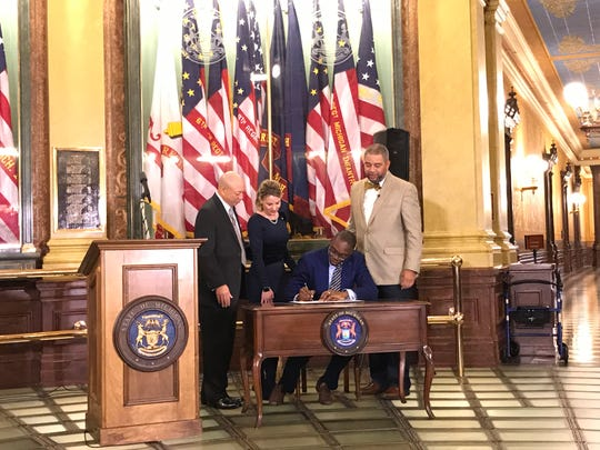 Lt. Gov. Garlin Gilchrist became the first black lieutenant governor in Michigan history to sign a bill into law in the Capitol rotunda on Thursday, Nov. 21, 2019.