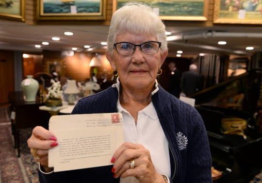 Sharon Oisten, of Allegan,  holds her letter.
