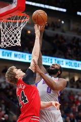 Detroit Pistons' Andre Drummond (0) shoots over Chicago Bulls' Lauri Markkanen during the first half.