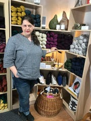 Meg Larned Croft, owner of Woven Art Yarn Shop in East Lansing.