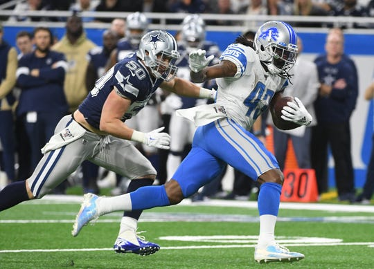 Running back Bo Scarbrough rushed for 55 yards in his Lions debut against the Cowboys.