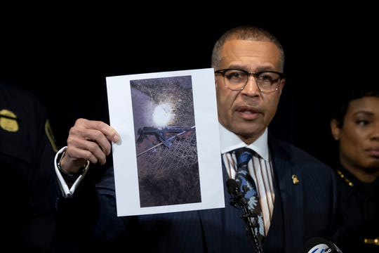 "Detroit Police Chief James Craig shows a photograph of an ""assault-type weapon"" used by the suspect as he speaks to the media at Detroit Public Safety Headquarters."