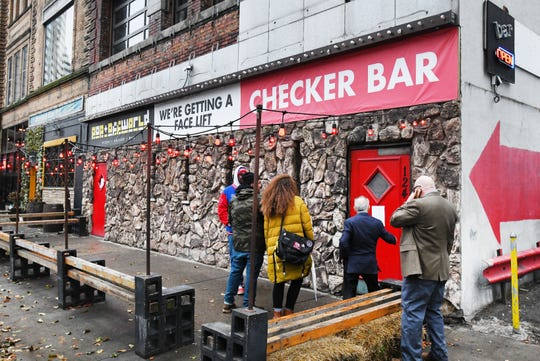 """Dozens entered the Checker Bar in Detroit for """"Let's Talk About Race"""" event, a discussion on race relations."""