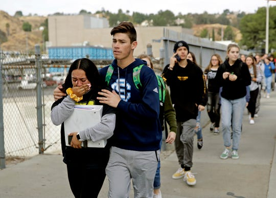 Students being escorted out of Saugus High School after a shooting on the campus in Santa Clarita, Calif. on Nov. 14, 2019.