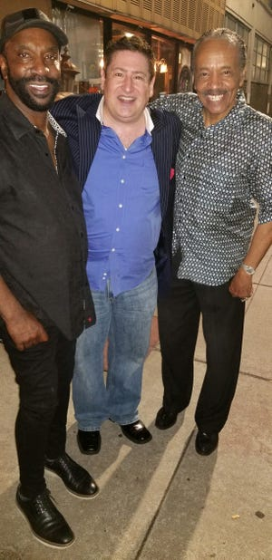 From left, Thomas McClary from the Commodores with photographer John Enot and D'Mongo's Cafe owner, Larry Mongo.