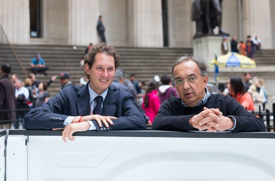 FCA NV Chairman John Elkann, left, attends a media event with the late chief executive officer, Sergio Marchionne in this Oct. 13, 2014, file photo.