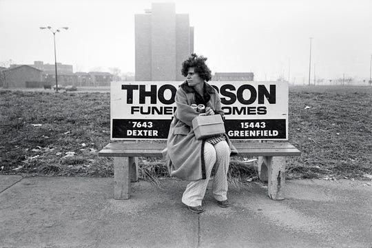 "Desolation crowds Glenn Triest's 1980 ""Woman Waiting for Bus, Warren Ave., First Day of Spring."""