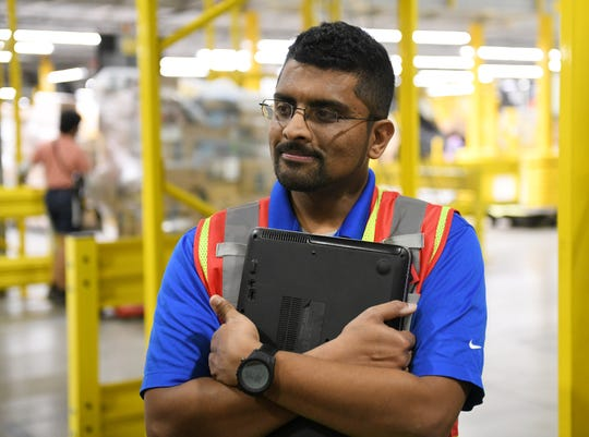 Avi Prakash is operations manager at the Amazon Brownstown Sortation Center and works with Kevin Blackburn.