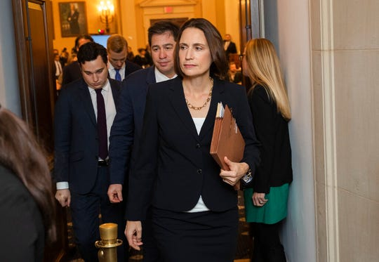 Former White House national security aide Fiona Hill, leaves the hearing room for a break during a public impeachment hearing, Thursday, Nov. 21, 2019.