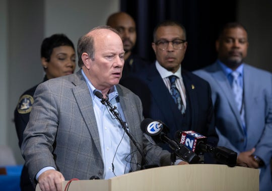 Detroit Mayor Mike Duggan speaks to the media Thursday about two officers who were shot while responding to a home invasion on Detroit's west side.