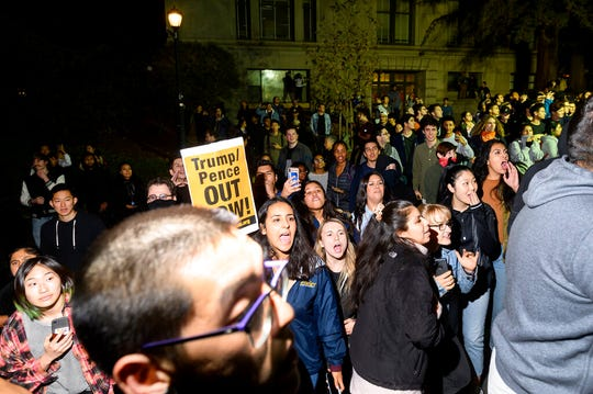 Protesters yell at audience members leaving a speech by conservative commentator Ann Coulter on Wednesday, Nov. 20, 2019, in Berkeley, Calif.