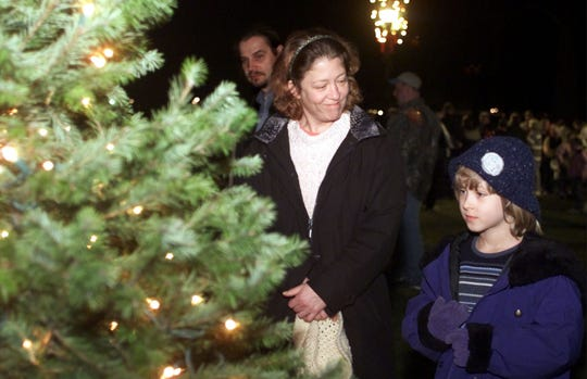 Kate Walton of Elmira and her daughter Lily, 7, get an up-close look at the Christmas tree Thursday in Brand Park in Elmira after the holiday tree-lighting ceremony in 2001.