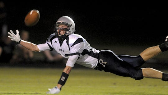 Hamilton Carr, diving for the ball against Henderson County, played for Reitz's 2009 Class 4A state football champions and was later a member of USI's NCAA Division II baseball championship team.
