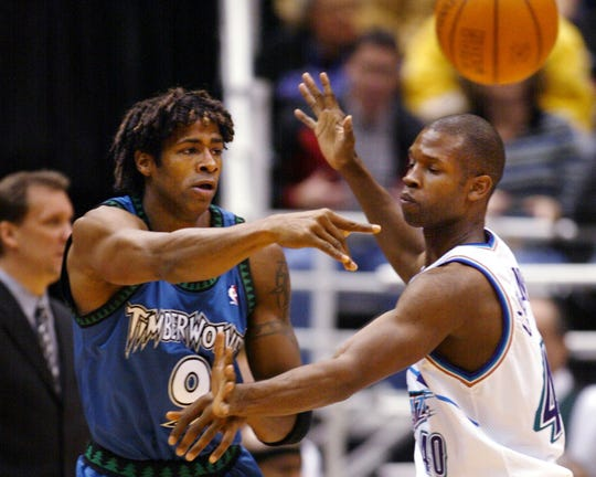 Minnesota Timberwolves guard Kendall Gill, left, gets a pass by Utah Jazz guard Calbert Cheaney, right, during the first half Friday, Nov. 29, 2002, in Salt Lake City. (AP Photo/Steve C. Wilson)