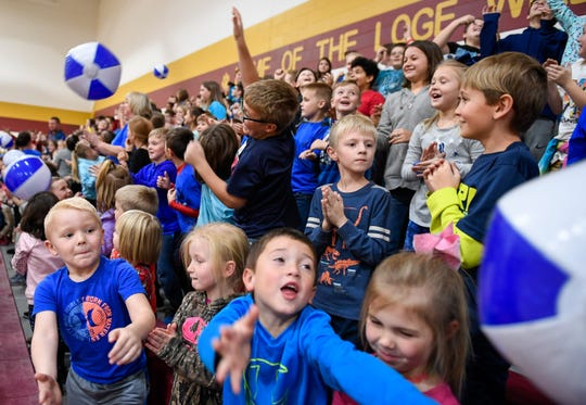 Loge Elementary students celebrate with beach balls during a special assembly to celebrate earning a Blue Ribbon School Award, the first such award in Warrick County history Thursday, November 21, 2019.