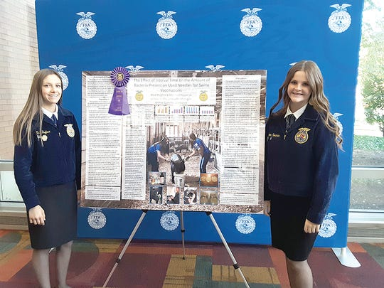 Alice Hughes (left) and Shannon Rossman, both three-year members of the Jonesville FFA Chapter, not counting their junior high school years.