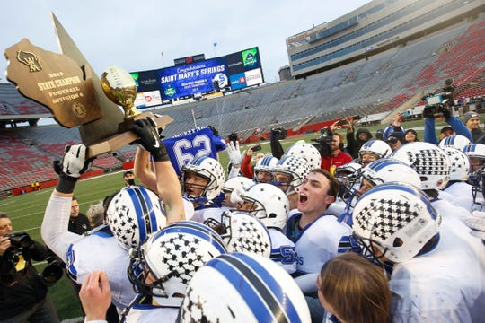 St. Mary's Springs players hoist the championship trophy after the WIAA Division 6 state championship game Nov. 21, 2019, at Camp Randall Stadium in Madison. The Ledgers defeated Regis 7-0.