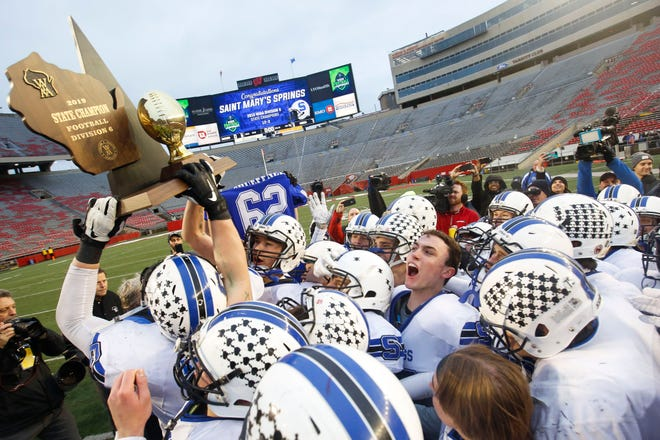 St. Mary's Springs players hoist the championship trophy after the WIAA Division 6 state championship game Nov. 21, 2019, at Camp Randall Stadium in Madison.