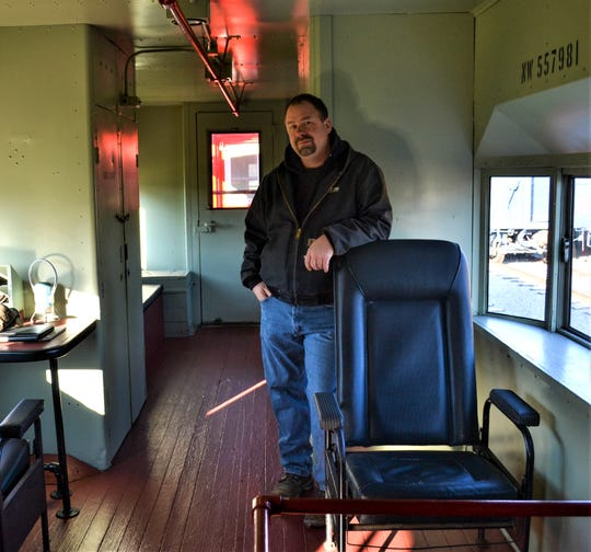 Dwayne Fuehring, Vice President of Mad River & NKP Railroad Museum, stands inside a caboose which will take children and their families on short rides during the Holiday Train event this Christmas season.