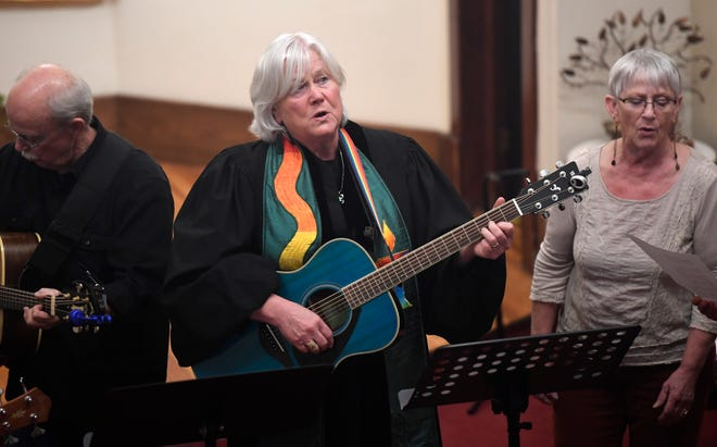 The Rev. Laurel Liefert sings and plays the guitar during the Transgender Day of Remembrance at Namaqua Unitarian Universalist Congregation in Loveland, Colo. on Wednesday, Nov. 20, 2019.