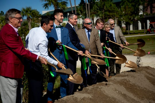 Members of the Florida Gulf Coast University Board of Trustees pose for a groundbreaking photo along with FGCU President Mike Martin, fourth from right, and Water School Director Greg Tolley, third from right, during the groundbreaking of the Water School at Florida Gulf Coast University in Estero on Thursday, Nov. 21, 2019. The new building, which will be the largest academic building on campus, is set to open in the fall of 2021.