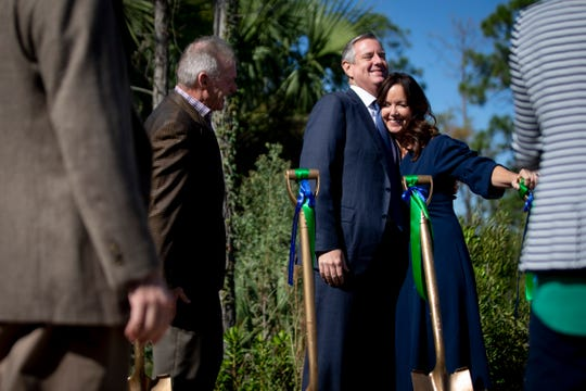 Florida State Senator Lizbeth Benacquisto, right, hugs Blake Gable, chair of the FGCU Board of Trustees, during the groundbreaking of the Water School at Florida Gulf Coast University in Estero on Thursday, Nov. 21, 2019.