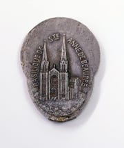 A commemorative medallion of the Basilique de Ste. Anne de Beaupre in Quebec was found on the property of Randy Polzin, vice president of the Crivitz-Stephenson Historical Society board, in Crivitz about two years ago. It is believed to be about 120 years old.