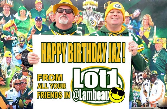 Scott Schwartz GreenBay, left, and Justin Sipla of Iowa City, Iowa, wish Jaz Singh a happy birthday in October. Singh, a Packers fan from Perth, Australia, is attending all the team's games this season and has a bunch of new mates in Lot 1 at Lambeau Field.