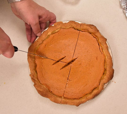One of about 40 pumpkin pies is sliced for service at a previous Community Thanksgiving Dinner at Sturgeon Bay United Methodist Church. The church serves about 150 people each year at the church, with a similar number of take-out and home delivery meals