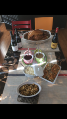 The spread at Caroline Bena-Varnier's house includes turkey and pumpkin pie, along with French elements like French wine, cheese and a baguette.