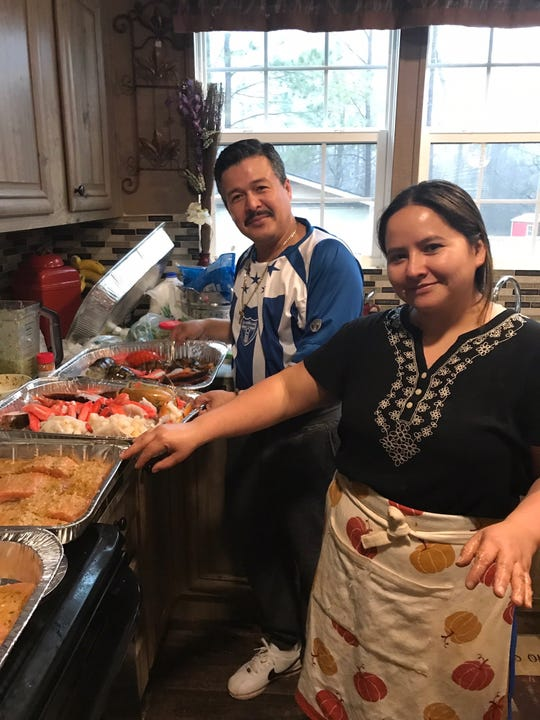 Sarai Monterroso and her husband, Roland, cook their Thanksgiving meal together, mixing traditional dishes like turkey with dishes like flan and Mexican rice, from their countries of Honduras and Mexico.