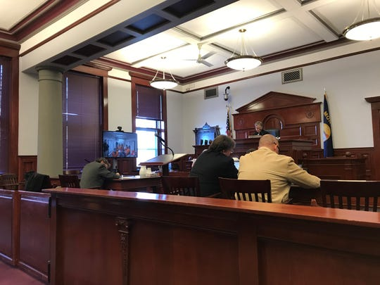 Judge Elizabeth Best prepares to see three suspects in the homicide of a 5-year-old child make their initial appearances Thursday in Cascade County District Court.