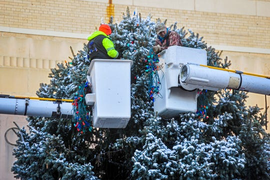 City workers place lights on the city Christmas tree in front of the Civic Center. The Christmas Stroll on Central Avenue is 5 p.m. to 9 p.m. Friday (Dec. 6).