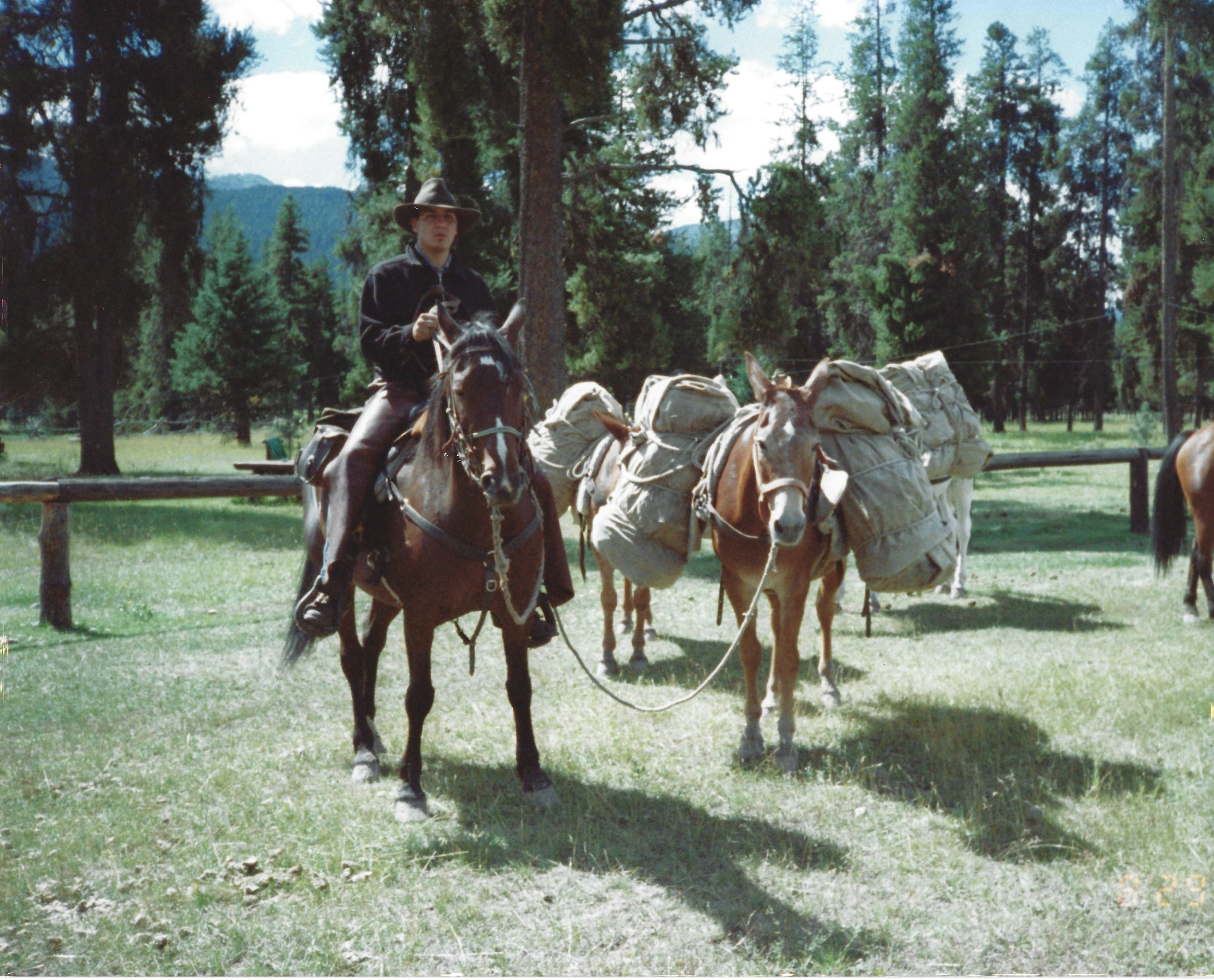 Tyson RunningWolf leads a pack trip when he was younger.