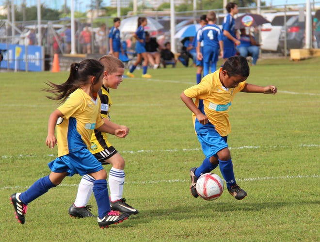 The Community First/Days Inn Dededo Soccer Club and the NAPA Rovers play in a Week 9 match of the Triple J Auto Group Robbie Webber Youth Soccer League's U6 division at the Guam Football Association National Training Center.