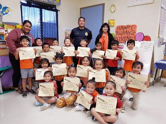 Adacao Elementary School students in Ms. Raquel Flores's class received the home fire safety award presented by Guam Fire Department Battalion Chief Edward Flores on Nov. 20. The class was given a family project to update their fire escape plan in addition to completing a fire and earthquake safety checklist.  First row: Aleah Manley, Anne Oiph Adelbai, Alexi Galvez, and Kiara Bamba. Second row: Kamaeya Mendiola, Taelorjaiye Camacho, Izi-Haze Saures, Payton Finona, Kamica Mundo, and Isis Marie Castro. Third row:Daron Unchangco, Marcus Ceasar, Rotsen Pitto, Jeremiah Diaz, Yu Zhu, Gianyosef Camacho, Konnor Topasna, Allezander Tajalle, and Ian Santiago-Venzlauskas Back row: Maddy Santos, teacher assistant; Edward Flores; and Raquel Flores, teacher.