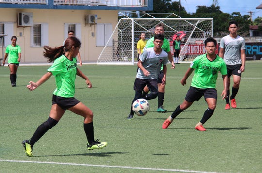 The ASC Trust Islanders and the GPSI Southern Cobras play in a Week 9 match of the Triple J Auto Group Robbie Webber Youth Soccer League's U16 division at the Guam Football Association National Training Center.