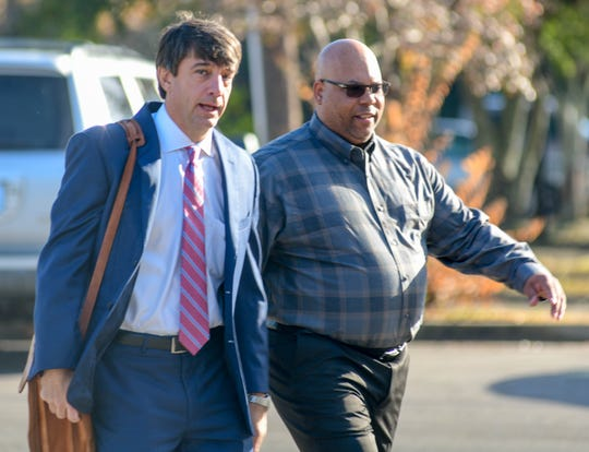 Thomas Edward Sturdavant, right, a former doctor who pleaded guilty to health care fraud, walks into the William M. Colmer Federal Courthouse in Hattiesburg, Miss., with his attorney Scott Schwartz,  Thursday, Nov. 21, 2019.