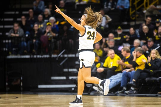 Iowa guard Gabbie Marshall (24) reacts after making a 3-point basket during a NCAA non-conference women's basketball game, Wednesday, Nov. 20, 2019, at Carver-Hawkeye Arena in Iowa City, Iowa.