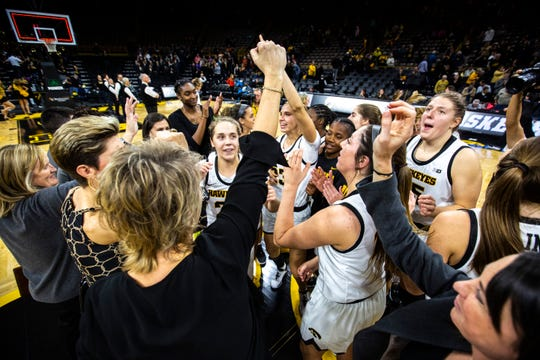 Iowa Hawkeyes players huddle up with Iowa head coach Lisa Bluder after a NCAA non-conference women's basketball game, Wednesday, Nov. 20, 2019, at Carver-Hawkeye Arena in Iowa City, Iowa. The Hawkeyes defeated Princeton, 77-75, in OT.