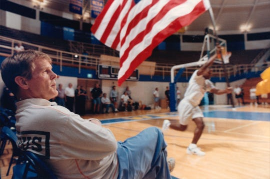Actor Nick Nolte, starring as a college basketball coach, watches from the bench during dress rehearsal for pre-game activities at Case Arena in Frankfort on July 7, 1993.