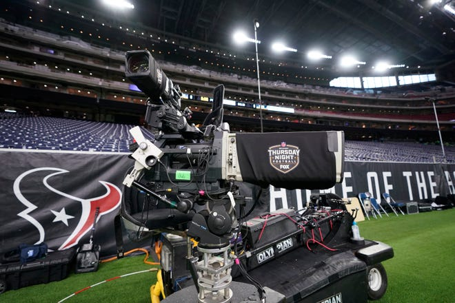 A TV camera is seen before an NFL football game between the Houston Texans and the Indianapolis Colts Thursday, Nov. 21, 2019, in Houston.